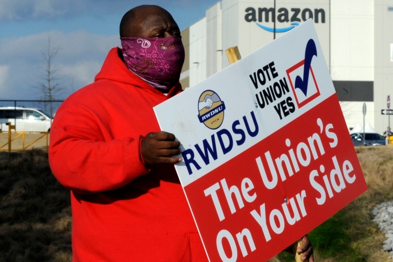 A small but growing number of Amazon workers at this warehouse in Bessemer, Alabama in the United States are publicly calling for a union, and with just a few days to go until the vote closes on March 29, the majority of the more than 5,800 workers at the site still haven't cast their ballots [File: Jay Reeves/AP Photo]