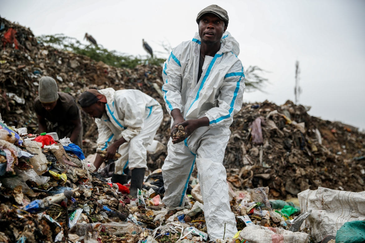Duncan Wanjohi (right) and Kelvin Kimani scavenge for recycled materials in Dandora, the largest garbage dump in Kenya's capital of Nairobi. [Brian Inganga/AP Photo]