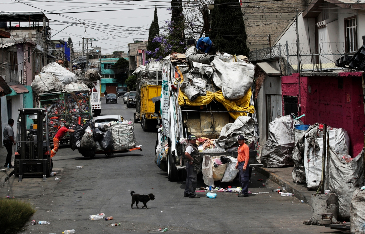 Waste pickers unload rubbish in Mexico City. [Marco Ugarte/AP Photo]