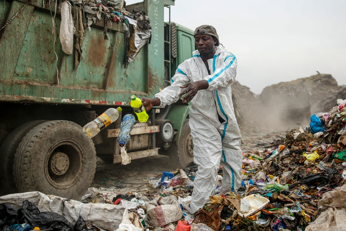 Duncan Wanjohi scavenges recyclable materials for a living at a garbage dump at Dandora, on the outskirts of Nairobi. [Brian Inganga/AP Photo]