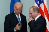 Then-Vice President of the United States Joe Biden meets with Vladimir Putin, then Russian prime minister, in Moscow in 2011 [File: Alexander Zemlianichenko/The Associated Press]