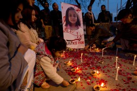 In this photo from January 11, 2018, a girl lights a candle during a memorial for Zainab Ansari in Islamabad, Pakistan [File: BK Bangash/AP Photo]