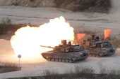 In this April 26, 2017, file photo, US Army's M1 A2 tanks fire during South Korea-US joint military live-fire drills at Seungjin Fire Training Field in Pocheon, South Korea, near the border with North Korea [File: Ahn Young-joon/ AP]