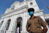 A police officer stands guard outside St Anthony's church, one of the targets of the 2019 Easter Sunday attacks, on the first anniversary of the deadly bombings in Colombo [File: Eranga Jayawardena/AP]