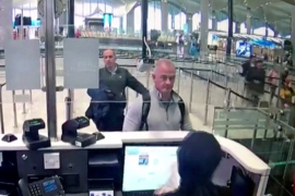 A security camera video shows Michael L Taylor and George-Antoine Zayek at passport control at Istanbul airport in Turkey on December 30, 2019 [File: DHA via AP Photo]