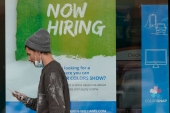 The US jobs market is back on track after a brutal December and slow start to January, when COVID-19 cases were rampaging throughout the country, ushering in business-sapping restrictions [File: Tony Dejak/AP]