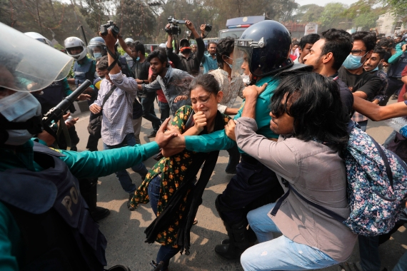 Bangladeshi students clash with police during the protest over Ahmed's death in Dhaka [Mahmud Hossain Opu/AP]