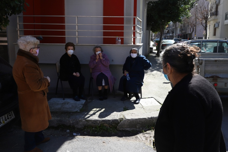 People gather outside their houses after an earthquake in Larissa city, central Greece [Vaggelis Kousioras/AP]