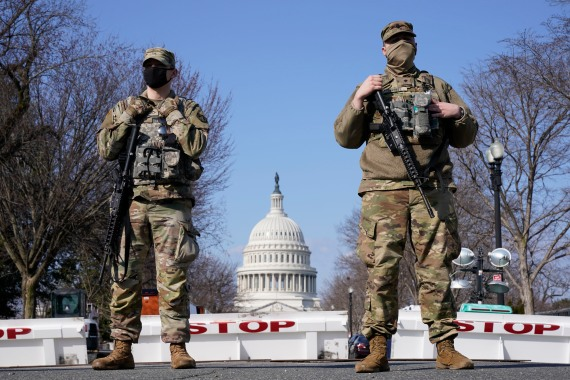 National Guard troops keep watch on the United States Capitol as police say they have uncovered plans by a militia group to possibly breach the US Capitol on Thursday [Jacquelyn Martin/AP Photo]