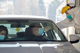 Bosnians get tested for COVID-19 at a drive-through facility, in Sarajevo, Bosnia on March 4, 2021. Bosnia is reporting a rise in daily new infections following a relatively stable situation [Eldar Emric/AP]