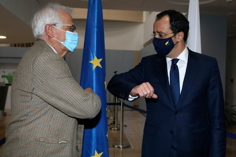 European Union foreign policy chief Josep Borrell, left, and Cyprus Foreign Minister Nicos Christodoulides greet each other prior to their meeting in Nicosia [Katia Christodoulou via AP]