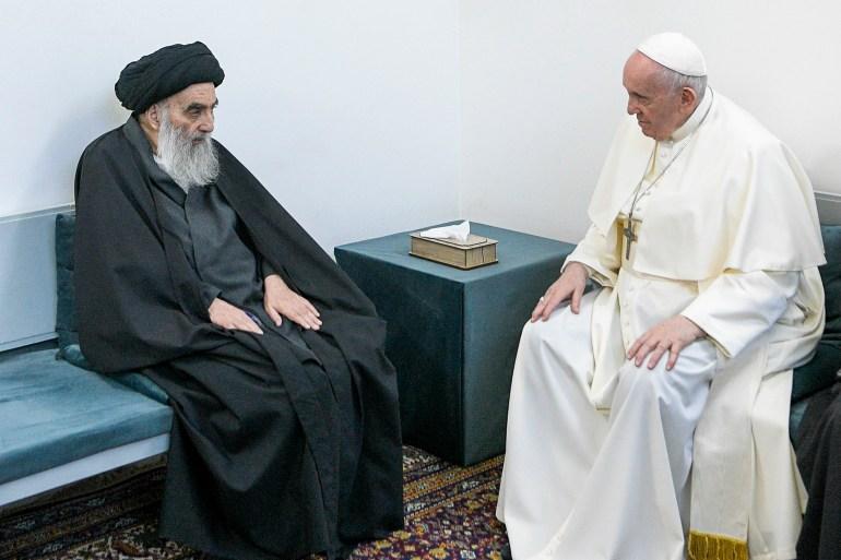 Pope Francis, right, meets with Grand Ayatollah Ali al-Sistani in Najaf, Iraq [Vatican Media/AP]