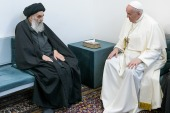Pope Francis, right, meets with Grand Ayatollah Ali al-Sistani in Najaf, Iraq [Vatican Media/AP]