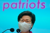 Carrie Lam listens to reporters' questions during a press conference in Hong Kong [Vincent Yu/ AP]