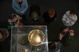 Visitors listen to a guide at the Museum for Islamic Art in Jerusalem on Wednesday [Maya Alleruzzo/AP]