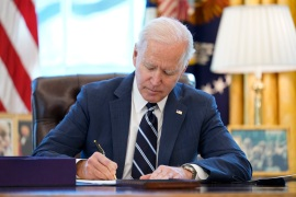 President Joe Biden signs the American Rescue Plan, a coronavirus relief package, in the Oval Office of the White House, March 11, 2021 [Andrew Harnik/AP Photo]