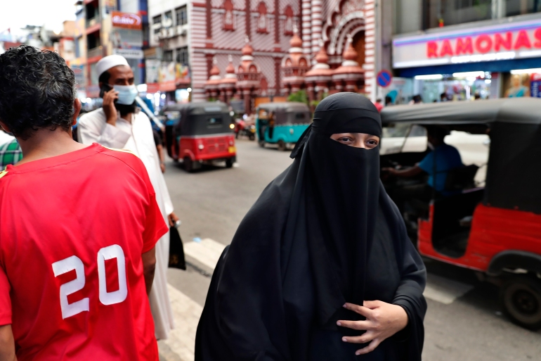 A burqa-clad Sri Lankan Muslim woman in the capital, Colombo [File: Eranga Jayawardena/AP]