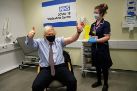 Britain's Prime Minister Boris Johnson gestures after receiving the first dose of the AstraZeneca vaccine at St Thomas Hospital in London, March 19, 2021 [File: Frank Augstein/AP Photo]