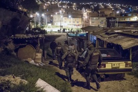 Police officers patrolling a neighbourhood on the outskirts of Bogota [File: Ivan Valencia/AP Photo]