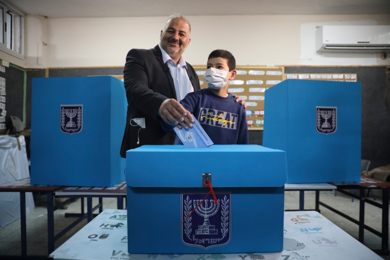 Mansour Abbas, leader of the United Arab List, votes at a polling station in Maghar, Israel [Mahmoud Illean/AP]