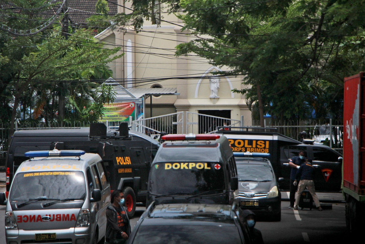 Police vehicles are parked near the church where the explosion took place. [Masyudi S Firmansyah/AP Photo]