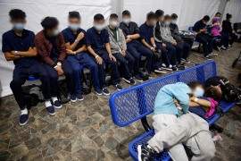 Young people wait to be processed inside the main detention centre for unaccompanied children in the Rio Grande Valley, in Donna, Texas [Dario Lopez-Mills/Pool via AP Photo]