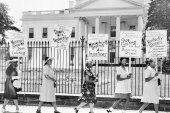 Picketers representing the National Association of Colored Women march past the White House in Washington, DC, July 30, 1956, carrying posters protesting the lynching of four Black people in Georgia [File: AP]