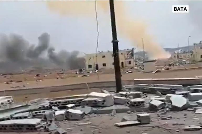 In the blast area, iron roofs were ripped off half-destroyed houses and lay twisted amid the rubble [Screengrab/Al Jazeera]