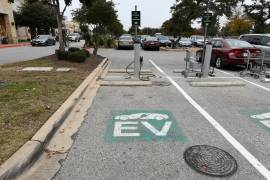 United States President Joe Biden's campaign in 2020 declined to endorse a specific date to end gas-powered vehicle sales, but he has vowed to dramatically boost electric vehicles and charging stations [File: Mohammad Khursheed/Reuters]