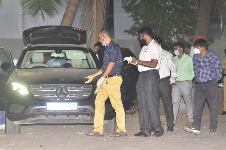 Indian officers investigating Sachin Vaze's Mercedes car following his arrest in connection with a probe into the recovery of explosives from a car parked near Antilia house of industrialist Mukesh Ambani [Anshuman Poyrekar/Hindustan Times via Getty Images)