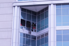 People stare out of windows broken by detainees at the City Justice Center in St Louis, Missouri, in February 2021 [Courtesy of ArchCity Defenders]