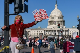 Advocates for DC statehood rally near the Capitol prior to a House of Representatives hearing on creating a fifty-first state, in Washington, Monday, March 22, 2021. The activists were able to gather near the Capitol building ahead of the DC (AP Photo/J. Scott Applewhite)