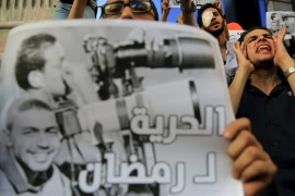 "Journalists take part in a protest against the detention of Ahmed Ramadan, a photojournalist with Egyptian private newspaper ""Tahrir"", in front of the Syndicate of Journalists in Cairo, Egypt on August 17, 2015 [Amr Abdallah Dalsh/Reuters]"