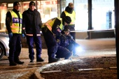 Police forensics team members work at an ax attack site where several people were wounded in Vetlanda, Sweden [Mikael Fritzon/TT News Agency via Reuters]