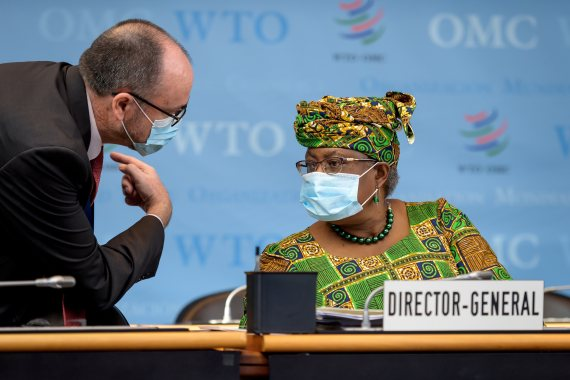 New Director-General of the World Trade Organization Ngozi Okonjo-Iweala on Monday attends a session of the WTO General Council upon her arrival at the WTO headquarters in Geneva, Switzerland [Fabrice Coffrini/Reuters]