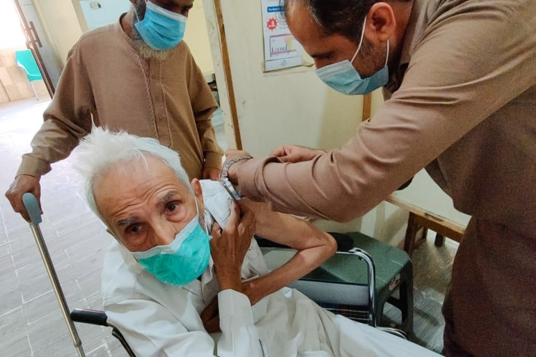 Basharat Ali Zaidi was among the first senior citizens to receive the vaccine in Pakistan [Abdullah Zaidi/Al Jazeera]