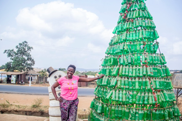 Jumoke Olowokere's giant Christmas tree, constructed from discarded bottles, has become a permanent fixture on the street near her office in Ibadan [Femi Amogunla/Al Jazeera]