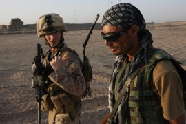 US Marine 1st Lt. Zachary Bennett talks with Afghan interpreter who goes by HM, during a joint patrol near Faqairan village, Nawa district, in Helmand province, southern Afghanistan, Saturday, September 19, 2009 (AP Photo/Brennan Linsley) (AP Photo)