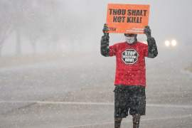 An activist in opposition to the death penalty protests during a snowstorm in Indiana, the United States, where public support for capital punishment is at its lowest since 1972, according to a recent Gallup poll [File: Bryan Woolston/Reuters]