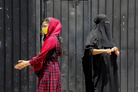 A burqa is an outer garment worn to cover the entire body and the face and is used by some Muslim women [Chamila Kareunarathne/EPA]