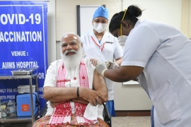 Indian Prime Minister Narendra Modi receiving a dose of COVID-19 vaccine in New Delhi [Handout via EPA]