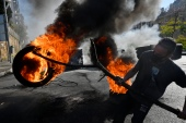 Anti-government protesters burn tyres to block a road during a protest against power cuts and the high cost of living [Wael Hamzeh/EPA]