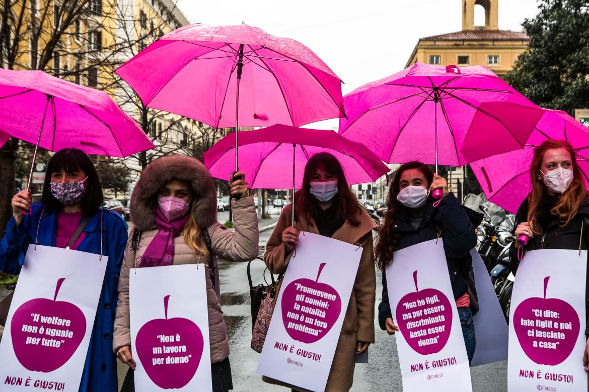 Activists of the Non una di Meno (Not One Less) movement demonstrate against structural violence and for economic independence in front of the Ministry of Economy on the occasion of International Women's Day, in Rome, Italy. [Angelo Carconi/EPA]