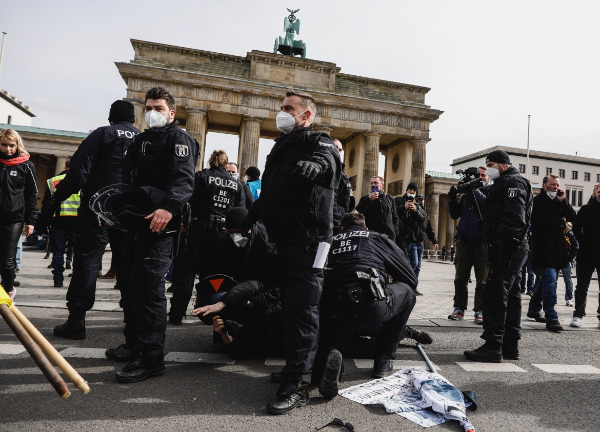 In Berlin, some 1,800 police officers were on standby for possible riots, but only about 500 protesters assembled at the city's landmark Brandenburg Gate. [Filip Singer/EPA]