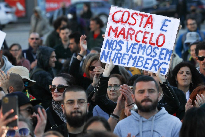 An anti-lockdown demonstration takes place in Lisbon, Portugal. [Antonio Cotrim/EPA]