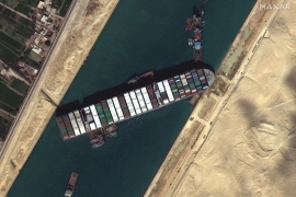 About 400 container ships were stuck in the Ever Given traffic jam in Egypt's Suez Canal, which also prompted a flurry of memes from a world eager to laugh - and plenty of kudos for the little excavator trying to free it [File: Satellite Image 2020 Maxar Technologies/EPA-EFE]