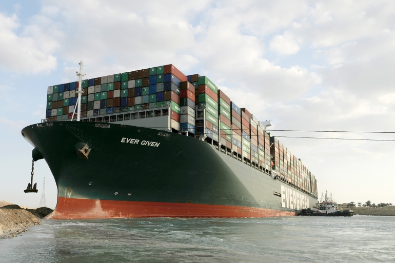 Reports on Monday said the container ship Ever Given, which has been blocking the Suez Canal for a week, was back afloat [File: Handout via EPA]