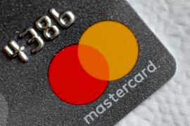 Mastercard is part of a growing roster of companies using compensation to drive the progress of environmental, social and corporate governance, also known as ESG [File: Thomas White/Reuters]