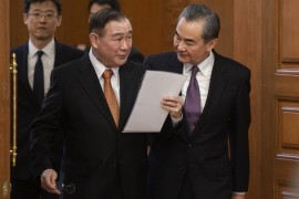Foreign Affairs Secretary Teodoro Locsin, pictured with his Chinese counterpart, Wang Yi, had promised that Manila would file diplomatic protests 'every day' as long the Chinese vessels remain within the Philippine EEZ [File: Nicolas Asfouri/AFP]