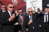 Russian President Vladimir Putin, right, and Turkish President Recep Tayyip Erdogan eat ice cream during the MAKS 2019 International Aviation and Space Salon opening ceremony in Zhukovsky outside Moscow [File: Handout/Turkish Presidency Press Office/AFP]